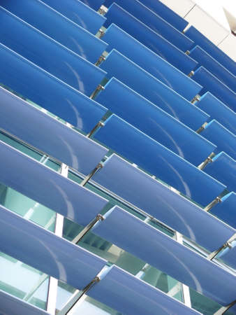 baffle: Close-up view of a curtain wall with a system of blue brise-soleil