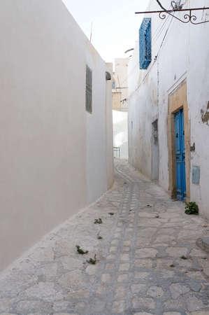 foreshortening: Tunisian foreshortening of medina in Sousse with white architectures Stock Photo