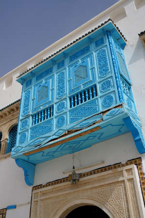 Traditional tunisian architecture with blue windows and white facades