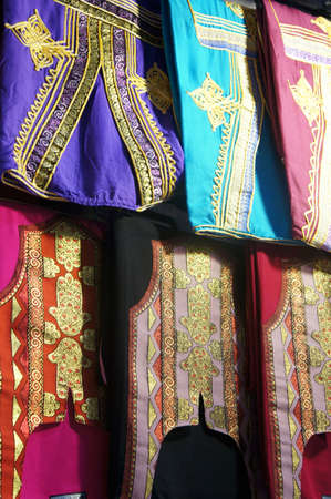 folkloristic: Tunisian colorful clothes hanging in a bazaar