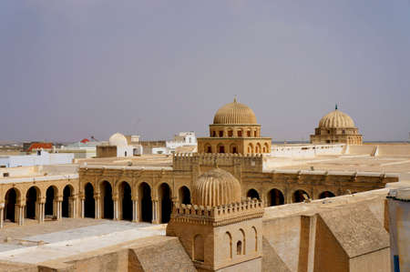 kairouan: Panoramic view of the great mosque of Kairouan in Tunisia with its stone walls