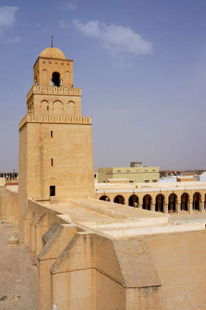 The great mosque of Kairouan and its minaret with ocher walls Stock Photo - 14982539