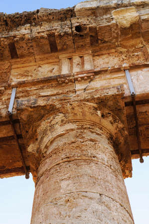Architectural detail of a capital in the colonnade of Segesta temple in Sicily photo