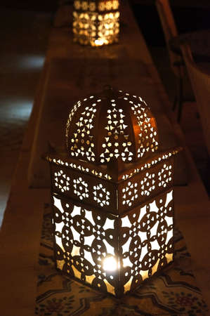 Close up view of an illuminated and metallic lantern from arab tradition photo