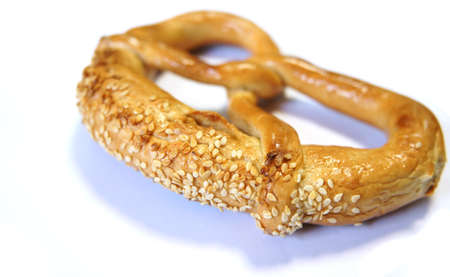 Close up view of a soft pretzel with sesame seeds photo