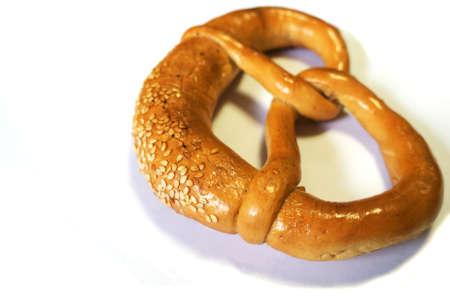 Close up view of a soft pretzel with sesame seeds photo