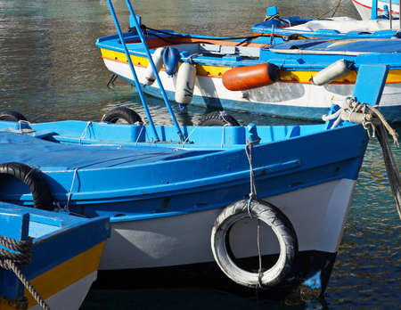 moored: Colorful fishing boat moored on crystalline sea in Sicily