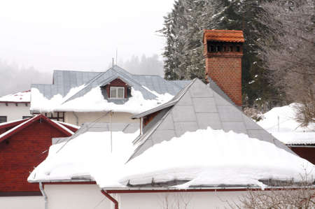 Roofs under the snow photo