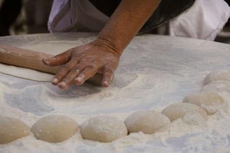 kneading: Woman kneading a dough Stock Photo