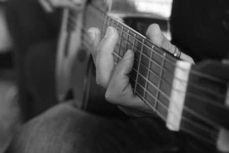 Man playing guitar black and white