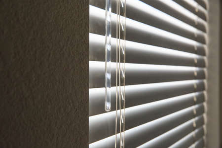 row houses: Gray window blinds Stock Photo