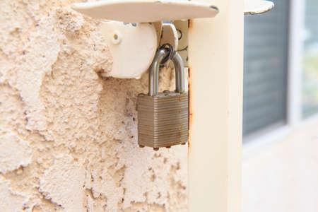 rusty padlock: Close Lock