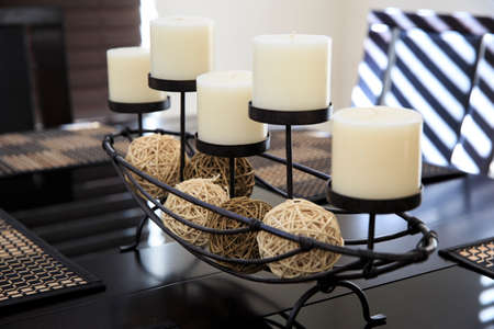 White candles on the table Imagens