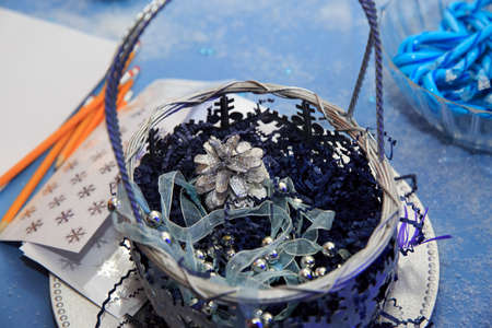 mitzvah: Silver cone in a basket for decoration