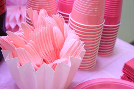 Pink plastic disposable tableware