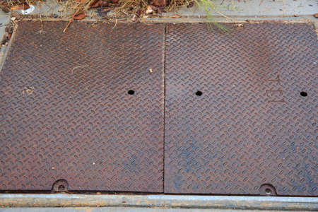 Rusty metal floor cover photo