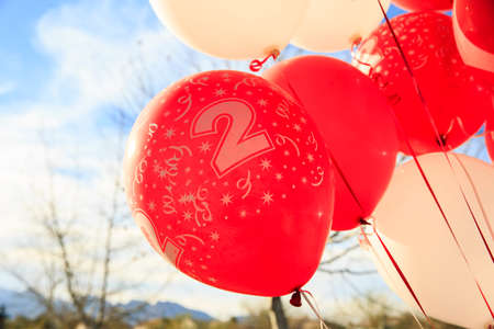 Red balloons for 2nd birthday party