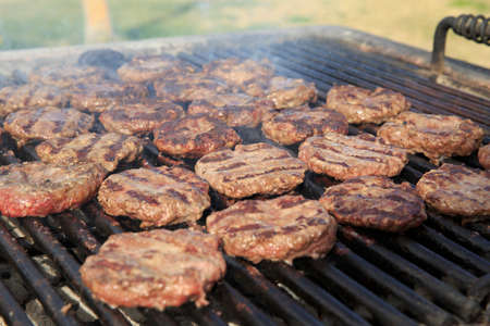 feast: Hamburger on the grill on 4th of July