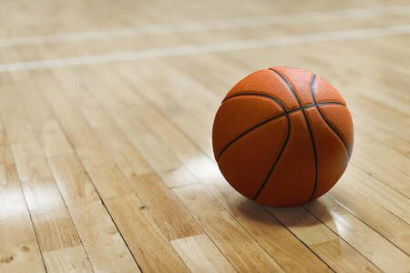 Basketball court wooden floor with ball isolated with copy-space