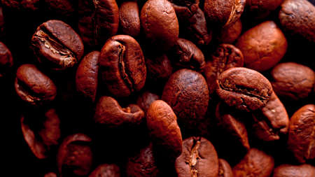 Fried Coffee beans background Close up