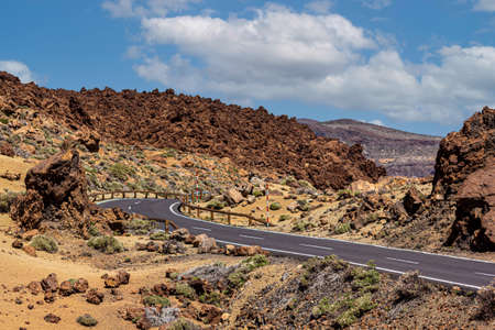 Teide National Park, lonely street in the middle of the caldera, near to the volcano. Text space.