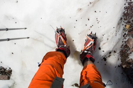 crampon: Crampons closeup. Crampons closeup. Crampon on winter boot for climbing, glacier walking or extreme hiking on ice and hard snow.