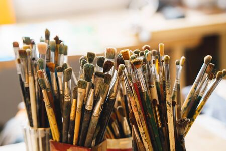 easel: Paint Brushes isolated in blur background, closeup