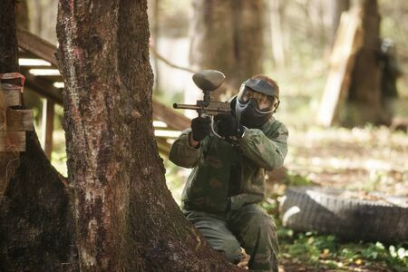 plastic soldier: A man in mask for paintball.