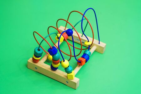 childrens abacus on the floor. isolated on background.