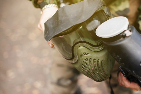 wearing: a man holds a mask for paintball closeup. Stock Photo