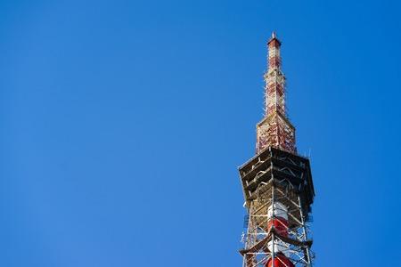 telecommunications tower on blue sky background. closeup Stock Photo