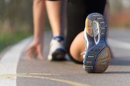 closeup woman runner shoe on park trail Stock Photo