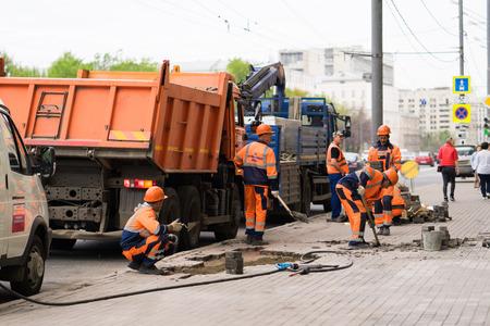 Moscow, Russia, 19 may 2017: workers repair sidewalk
