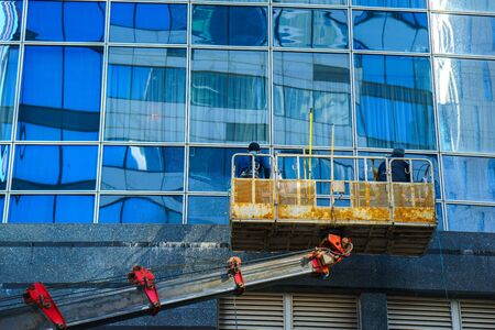 property management: Moscow, Russia, 16 may 2017: workers clean a window at the business center