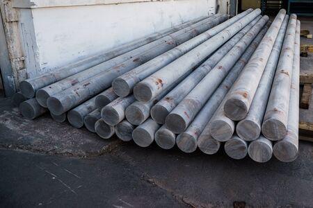 Stack of aluminium billets. Heap of aluminium bar in aluminum profiles factory