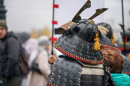 Samurai armour and helmet. Carnival costumes. Soldiers on outside Stock Photo