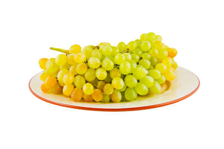 Grapes on plate. Isolated on white