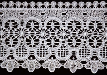 white lace over black background Standard-Bild