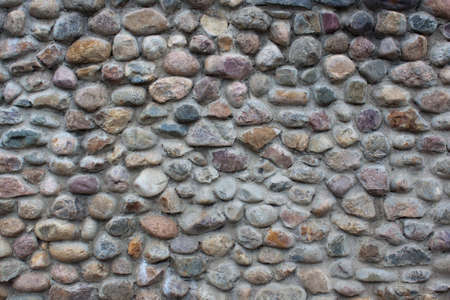 Wall of many-colored cobblestones
