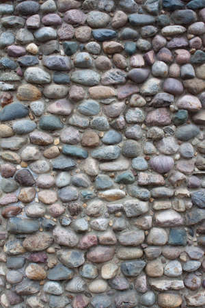 roundish: Wall of many-colored cobblestones