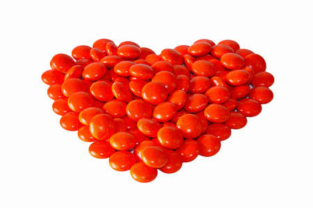heart made from red pills isolated on white