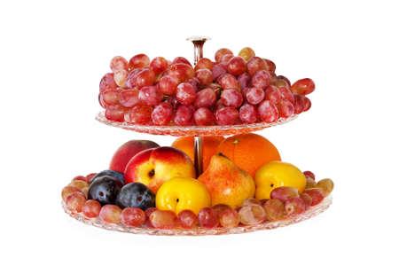 Vase of fruits isolated on white Standard-Bild