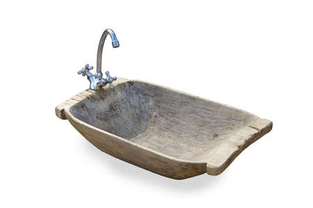 ancient wooden sink with modern water tap isolated on white Standard-Bild
