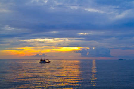 Beautiful sunset with fishing boat