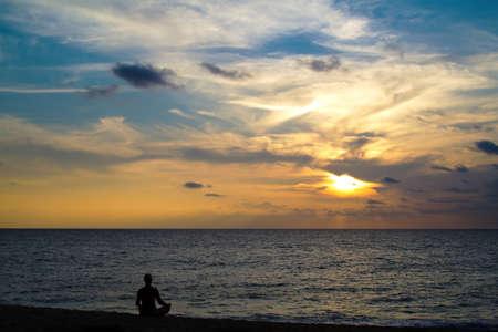 Meditation on sunset Standard-Bild
