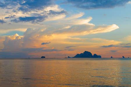 Beautiful sunset with silhouette of isles Standard-Bild