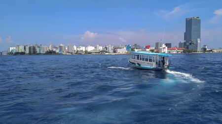 View of the city and boat from marina of Male, Maldives.