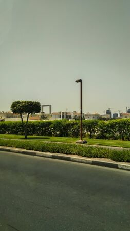 Dubai, United Arab Emirates. A cityscape view from a taxi. Summer holidays in Asia. Backpacking Southeast Asia. Dubai frame background.