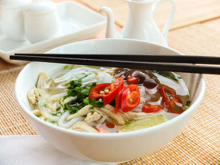 Asian chicken noodle soup photo