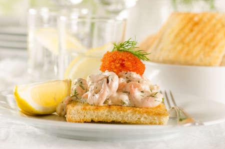 Toast skagen - shrimp and caviar on toast  Classic swedish appetizer